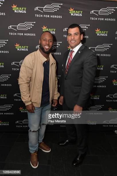 James White and Francisco Urena attend DraftKings Hosts Veterans Appreciation Event at MJ O'Connors on November 8 2018 in Boston Massachusett