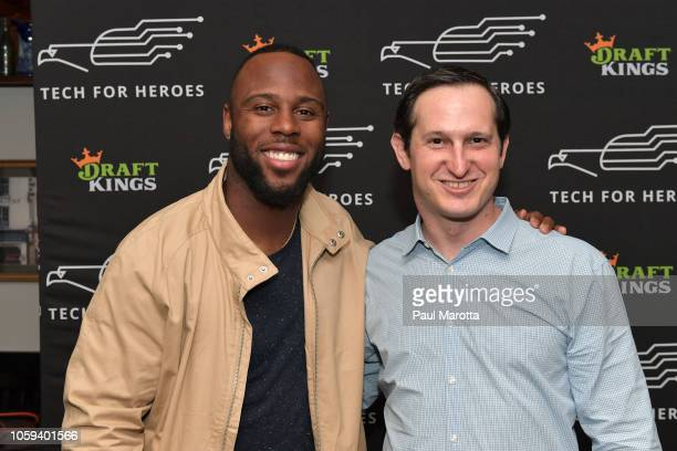 James White and Jason Robins attend the DraftKings Hosts Veterans Appreciation Event at MJ O'Connors on November 8 2018 in Boston Massachusett