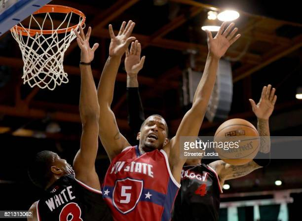 James White and Kenyon Martin of Trilogy and Dominic McGuire of TriState battle for a loose ball during week five of the BIG3 three on three...