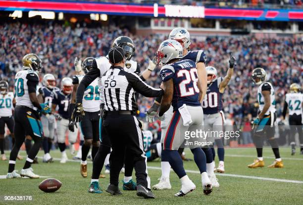 James White of the New England Patriots argues with a member of the Jacksonville Jaguars after a touchdown in the second quarter during the AFC...