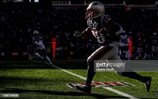 James White of the New England Patriots carries the ball during the second quarter of a game against the New York Jets at Gillette Stadium on...