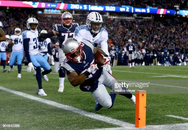 James White of the New England Patriots carries the ball for a touchdown as he is defended by Kevin Byard of the Tennessee Titans in the first...