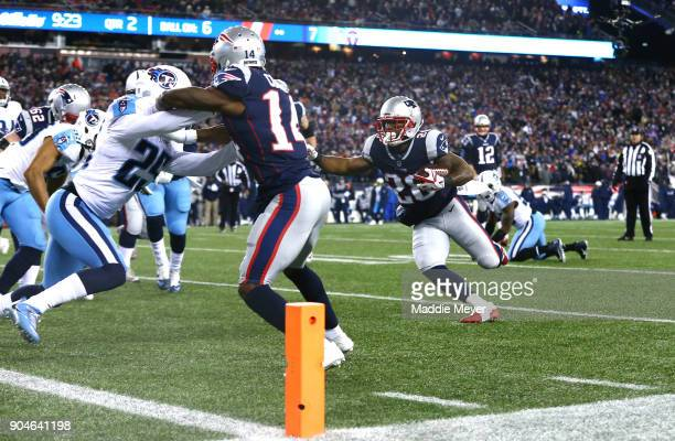 James White of the New England Patriots carries the ball for a touchdown in the second quarter of the AFC Divisional Playoff game against the...