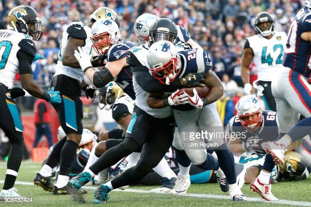 James White of the New England Patriots carries the ball for a touchdown in the second quarter during the AFC Championship Game against the...