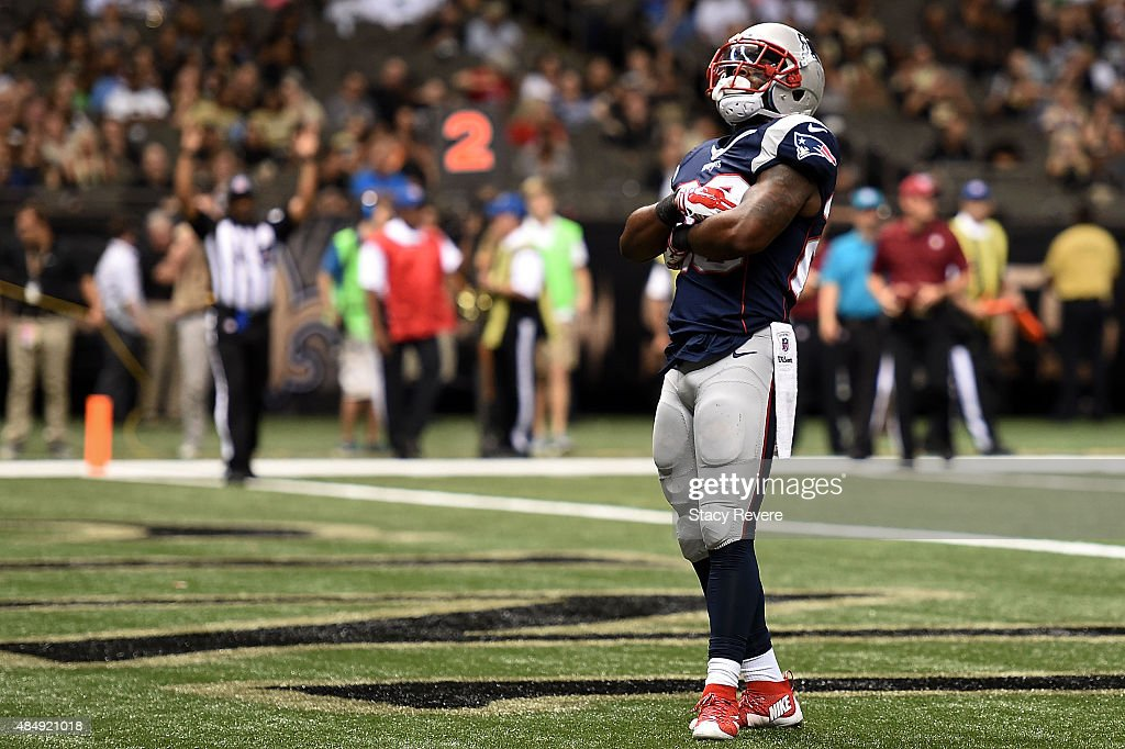 James White #28 of the New England Patriots celebrates a touchdown during the third quarter of a preseason game against the New Orleans Saints at the Mercedes-Benz Superdome on August 22, 2015 in New Orleans, Louisiana.