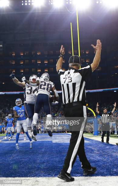 James White of the New England Patriots celebrates his touchdown with Rex Burkhead against the Detroit Lions during the third quarter at Ford Field...