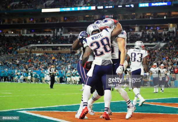 James White of the New England Patriots celebrates his touchdown with teammates in the fourth quarter against the Miami Dolphins at Hard Rock Stadium...