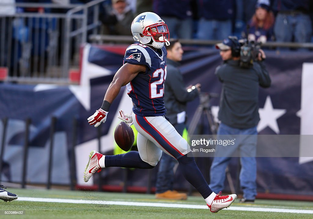 James White #28 of the New England Patriots celebrates scoring a touchdown during the second quarter against the Tennessee Titans at Gillette Stadium on December 20, 2015 in Foxboro, Massachusetts.