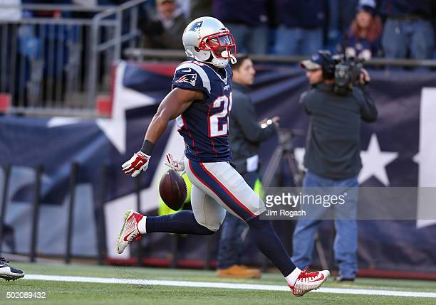 James White of the New England Patriots celebrates scoring a touchdown during the second quarter against the Tennessee Titans at Gillette Stadium on...