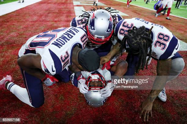James White of the New England Patriots celebrates with teammates after defeating the Atlanta Falcons 3428 in overtime to win Super Bowl 51 at NRG...