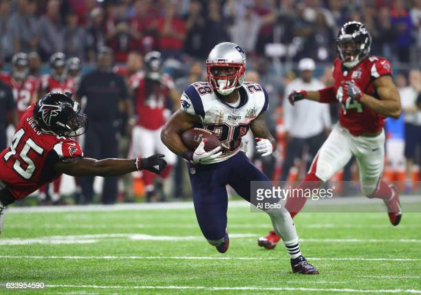 James White of the New England Patriots evades a tackle by Deion Jones of the Atlanta Falcons during Super Bowl 51 at NRG Stadium on February 5 2017...