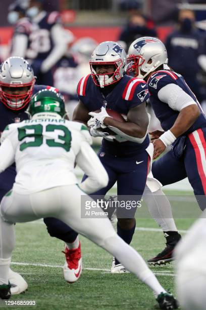 James White of the New England Patriots has a carry against the New York Jets at Gillette Stadium on January 3, 2021 in Foxborough, Massachusetts.