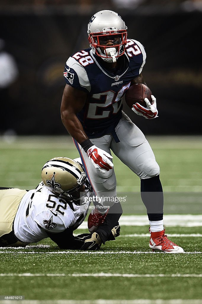 James White #28 of the New England Patriots is brought down by Henry Coley #52 of the New Orleans Saints during the third quarter of a preseason game at the Mercedes-Benz Superdome on August 22, 2015 in New Orleans, Louisiana.
