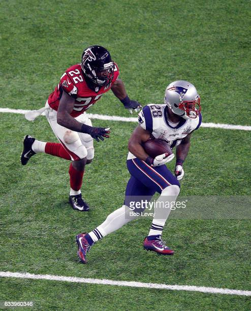 James White of the New England Patriots is pursued by Keanu Neal of the Atlanta Falcons during the third quarter during Super Bowl 51 at NRG Stadium...