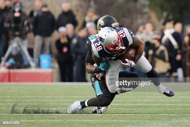 James White of the New England Patriots is tackled by Telvin Smith of the Jacksonville Jaguars in the second half during the AFC Championship Game at...
