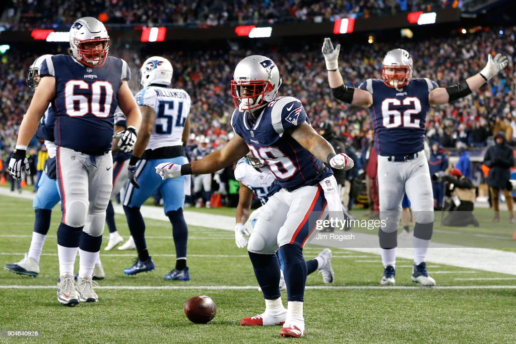 James White #28 of the New England Patriots reacts after scoring a touchdown in the second quarter of the AFC Divisional Playoff game against the Tennessee Titans at Gillette Stadium on January 13, 2018 in Foxborough, Massachusetts.
