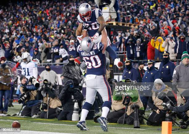 James White of the New England Patriots reacts with David Andrews after scoring a touchdown in the first quarter of the AFC Divisional Playoff game...