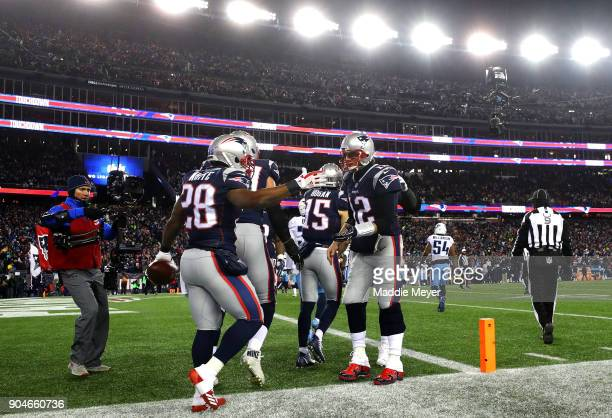 James White of the New England Patriots reacts with Tom Brady after scoring a touchdown during the second quarter in the AFC Divisional Playoff game...