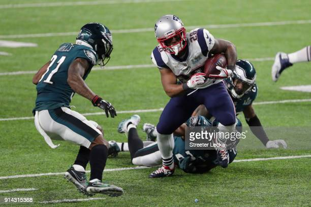 James White of the New England Patriots runs the ball past Jalen Mills of the Philadelphia Eagles for a 26yard touchdown during the second quarter in...