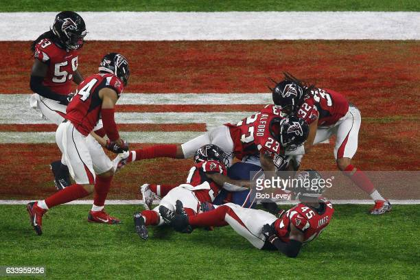 James White of the New England Patriots scores a 2yard rushing touchdown in overtime to defeat the Atlanta Falcons 3428 in Super Bowl 51 at NRG...