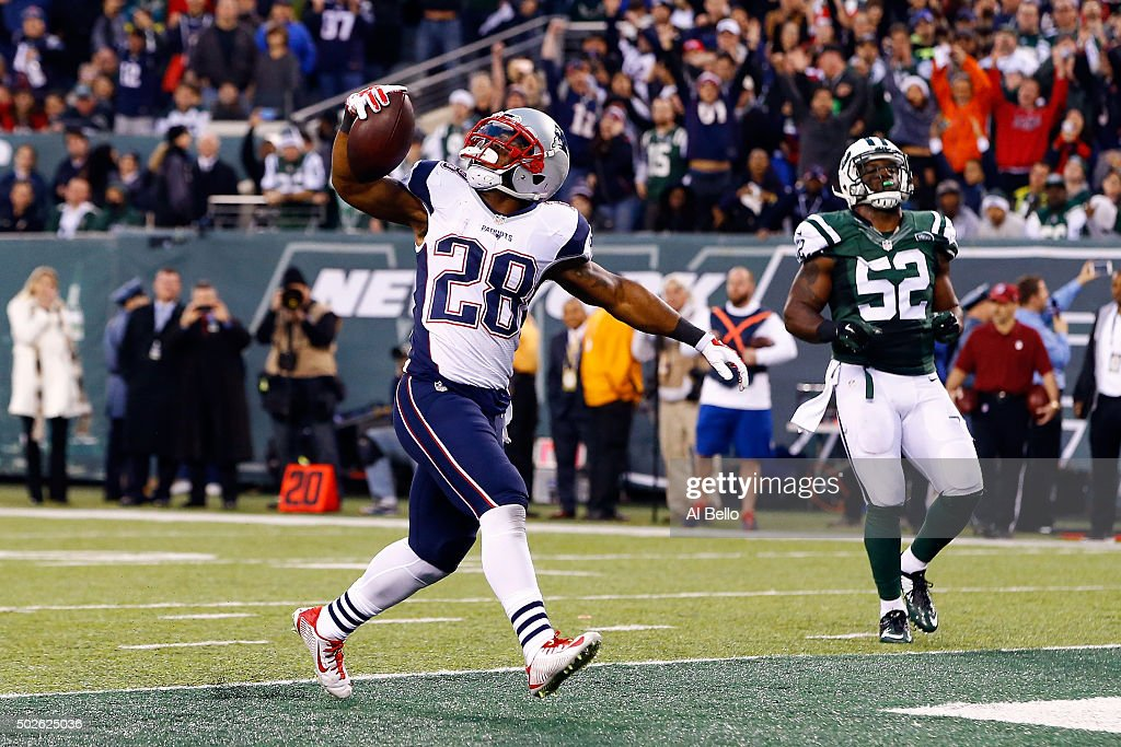 James White #28 of the New England Patriots scores a touchdown in the fourth quarter to tie the game against the New York Jets at MetLife Stadium on December 27, 2015 in East Rutherford, New Jersey.