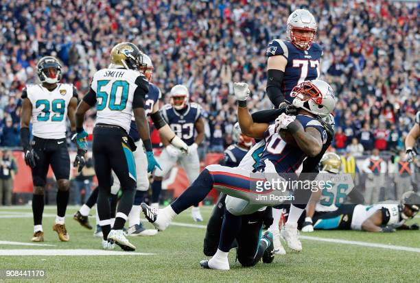 James White of the New England Patriots scores a touchdown in the second quarter during the AFC Championship against the Jacksonville Jaguars Game at...