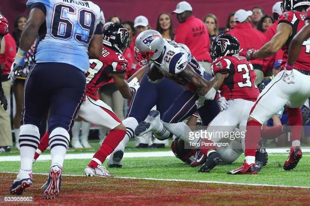 James White of the New England Patriots scores against the Atlanta Falcons during Super Bowl 51 at NRG Stadium on February 5 2017 in Houston Texas