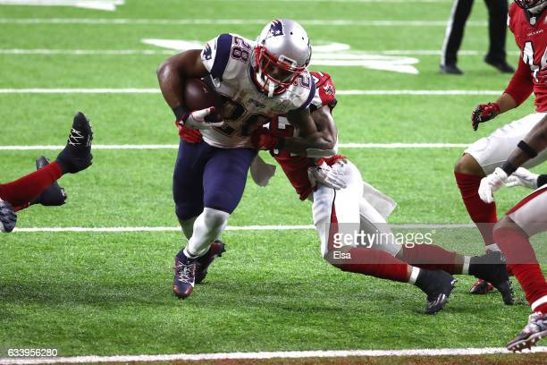 James White of the New England Patriots scores the game winning two yard touchdown in overtime against the Atlanta Falcons during Super Bowl 51 at...
