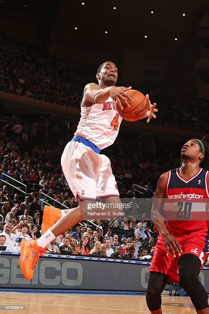 James White #4 of the New York Knicks grabs a rebound against Cartier Martin #20 of the Washington Wizards on April 9, 2013 at Madison Square Garden in New York City.