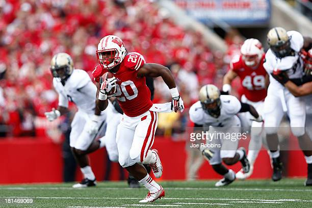 James White of the Wisconsin Badgers breaks free for a 70yard touchdown in the first quarter of the game against the Purdue Boilermakers at Camp...