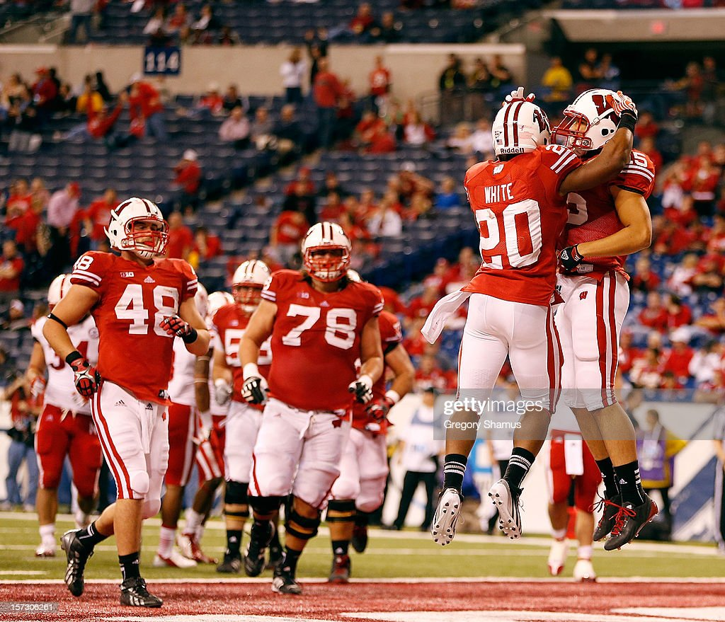 James White #20 of the Wisconsin Badgers celebrates a fourth quarter touchdown with teammates while playing the Nebraska Cornhuskers in the Big 10 Conference Championship Game at Lucas Oil Stadium on December 1, 2012 in Indianapolis, Indiana. Wisconsin won the game 70-31.
