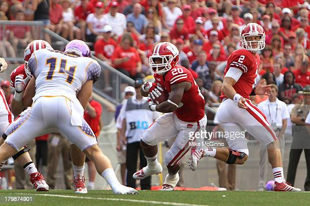 James White of the Wisconsin Badgers gets the hand off from Joel Stave and runs for some yards during the game against the Tennessee Tech Golden...