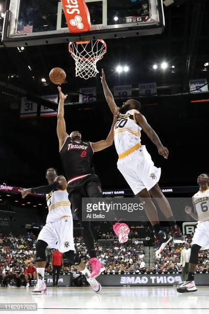 James White of Trilogy shoots against Donte Greene of Killer 3s during week four of the BIG3 three-on-three basketball league at Barclays Center on...