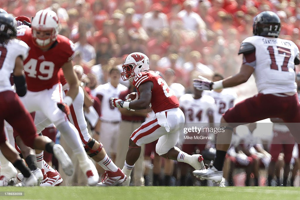 James White #20 Wisconsin Badgers runs for some yards in the first half of action against the UMass Minutemen at Camp Randall Stadium on August 31, 2013 in Madison, Wisconsin.