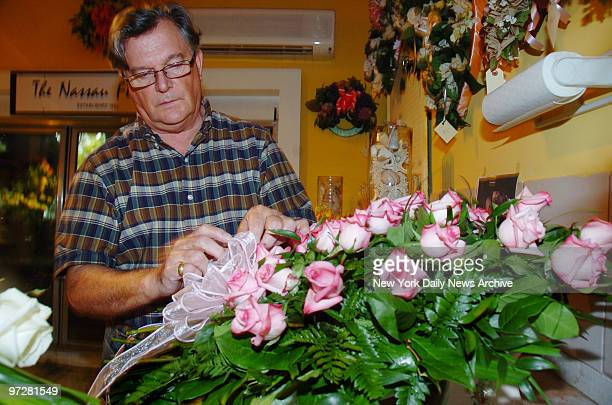 James Whitehead of the Nassau Florist prepares flower arrangements for tomorrow's funeral for the late Anna Nicole Smith She will be buried at...