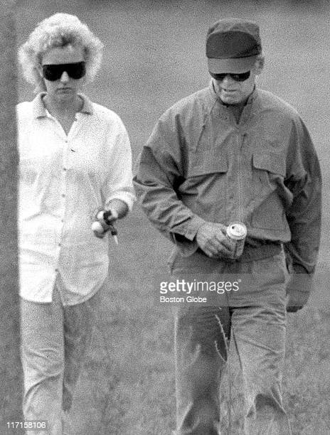 "James ""Whitey"" Bulger and Catherine Greig walk together."