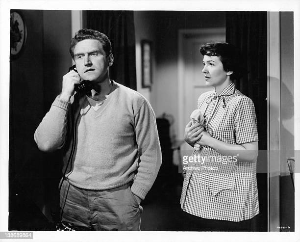 James Whitmore on the phone as Nancy Davis watches in a scene from the film 'The Next Voice You Hear' 1950