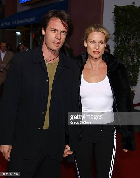 James Wilder and Nicollette Sheridan during The World Premiere of Bruce Almighty at Universal Amphitheatre in Universal City California United States