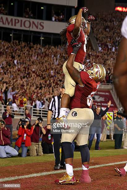 James Wilder Jr #32 of the Florida State Seminoles celebrates a touchdown during a game against the Miami Hurricanes at Doak Campbell Stadium on...