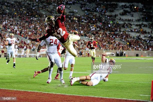 James Wilder Jr #32 of the Florida State Seminoles leaps over Sean Sylvia of the Boston College Eagles for a touchdown during a game at Doak Campbell...