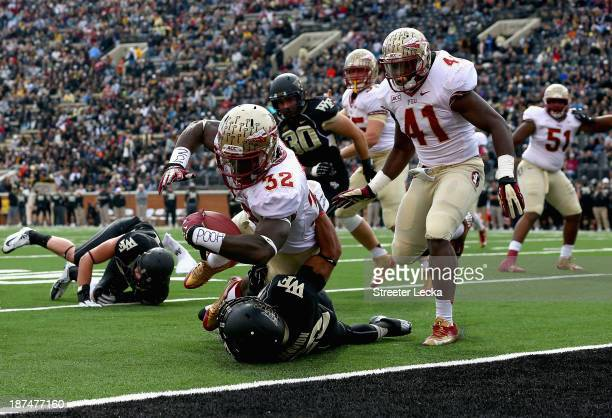 James Wilder Jr #32 of the Florida State Seminoles runs over Telvin Smith of the Florida State Seminoles for a touchdown during their game at BBT...