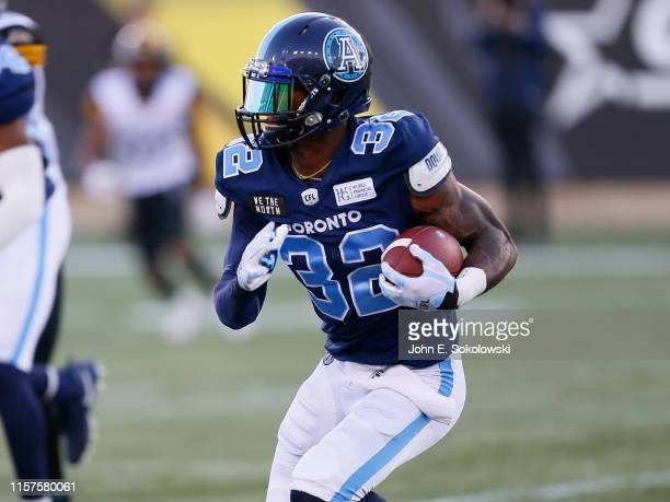 James Wilder Jr. #32 of the Toronto Argonauts carries the ball against the Hamilton Tiger-Cats during a pre-season game at Tim Hortons Field on June...