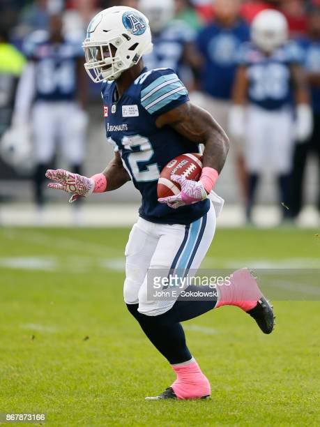 James Wilder Jr #32 of the Toronto Argonauts carries the ball against the Saskatchewan Roughriders during a game at BMO field on October 7 2017 in...
