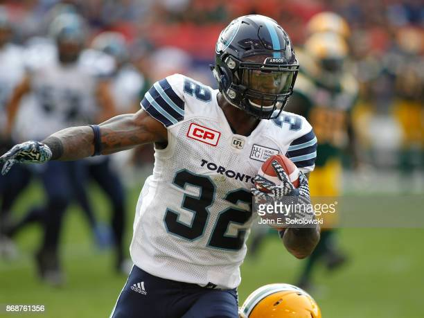 James Wilder Jr #32 of the Toronto Argonauts carries the ball against the Edmonton Eskimos during a game at BMO field on September 16 2017 in Toronto...