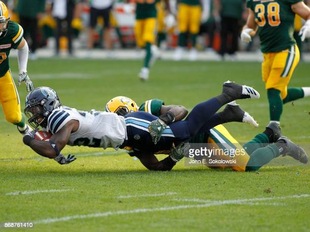James Wilder Jr #32 of the Toronto Argonauts dives for extra yards against the Edmonton Eskimos during a game at BMO field on September 16 2017 in...