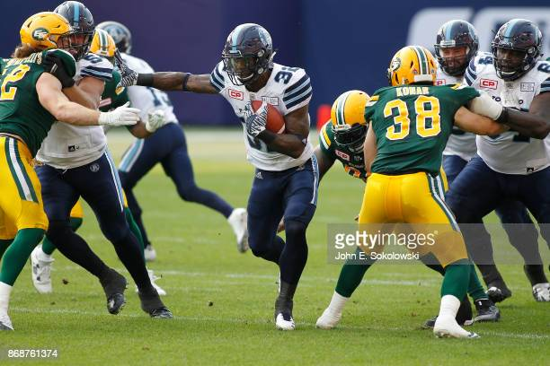 James Wilder Jr #32 of the Toronto Argonauts scores on a 76 yard rushing play against the Edmonton Eskimos during a game at BMO field on September 16...