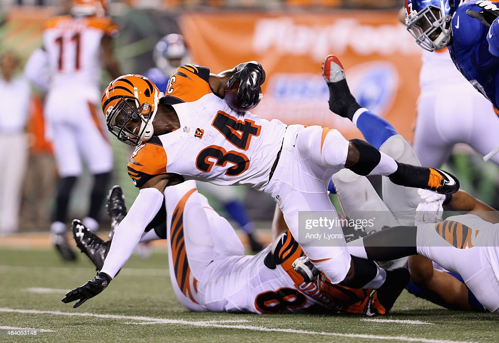 James Wilder Jr #34 of the Cincinnati Bengals runs with the ball against the New York Giants during an preseason game at Paul Brown Stadium on August 14, 2015 in Cincinnati, Ohio.