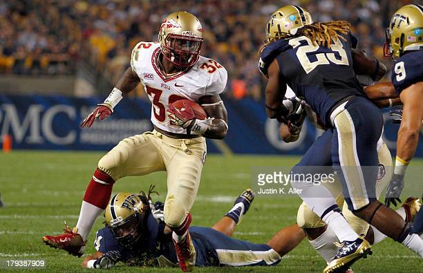 James Wilder of the Florida State Seminoles carries the ball in the first half against the Pittsburgh Panthers during the game on September 2 2013 at...