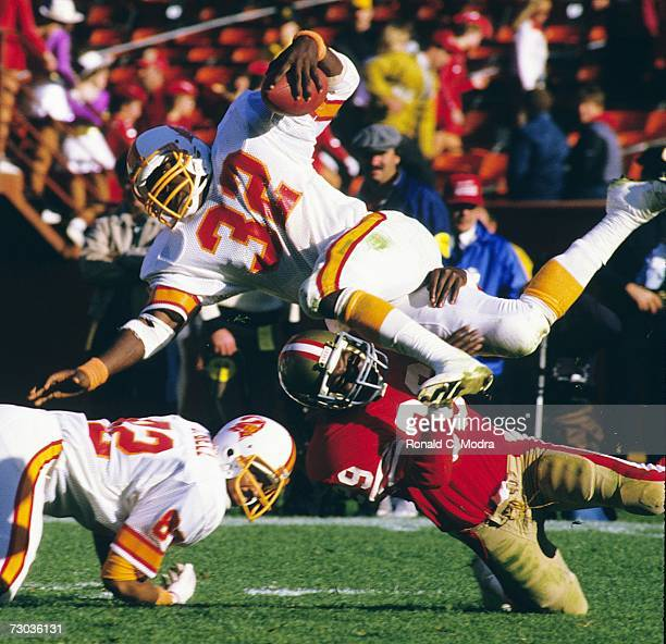 James Wilder of the Tampa Bay Buccaneers being upended during a game against the San Francisco 49ers on November 18 l984 in san Francisco California