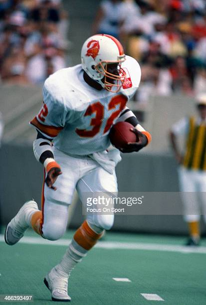 James Wilder of the Tampa Bay Buccaneers carries the ball against the Chicago Bears during an NFL football game September 8 1985 at Soldier Field in...